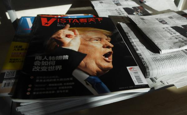 """A magazine's cover line in Beijing asks, """"How will Trump the businessman change the world?"""" on Dec. 28, 2016, days after then President-elect Donald Trump tapped outspoken China critic Peter Navarro for a top trade position."""