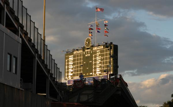 Wrigley Field, home of the Chicago Cubs, is also home to one of the few scoreboards still operated by hand.