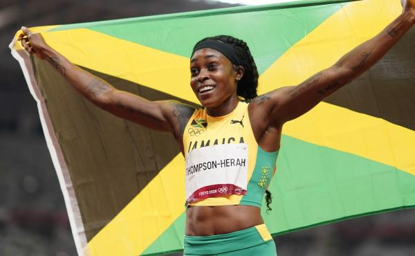 Elaine Thompson-Herah, of Jamaica, reacts after winning the final of the women's 200-meters at the 2020 Summer Olympics, Tuesday, Aug. 3, 2021, in Tokyo.