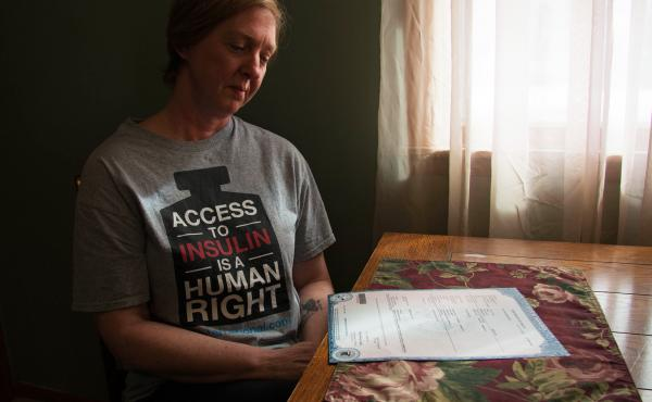 """""""It shouldn't have happened,"""" says Nicole Smith-Holt of Richfield, Minn., gazing at the death certificate of her son Alec Raeshawn Smith."""
