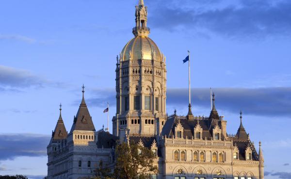 """Hartford is home to the Connecticut State Capitol and state legislature — as well as to major U.S. insurance firms. In 2019, those insurers spent what it took to defeat Connecticut's version of a """"public option"""" in health care, despite strong support am"""