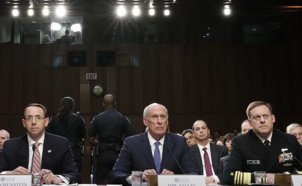 Acting FBI Director Andrew McCabe (left), Deputy Attorney General Rod Rosenstein, National Intelligence Director Dan Coats, and National Security Agency Director Adm. Michael Rogers are seated during a Senate Intelligence Committee hearing about the Forei