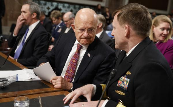 Director of National Intelligence James Clapper (center) talks with National Security Agency and Cyber Command chief Adm. Michael Rogers prior to testifying before the Senate Armed Services Committee.
