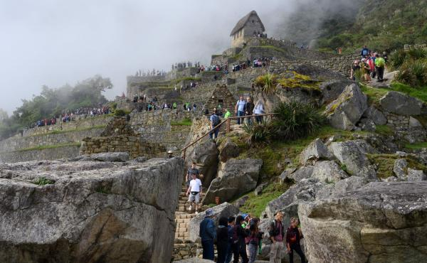 Tourists visit the Machu Picchu complex, the Inca fortress in the southeastern Andes of Peru in April. The government hopes a new airport will attract more tourists to the ancient site. That draws opposition from conservationists.