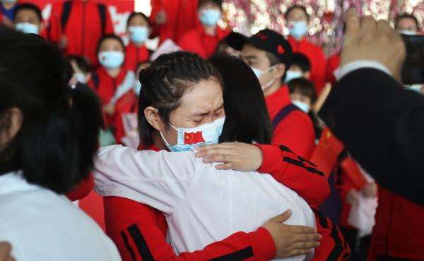 Health workers from Tongji Hospital in Wuhan, China, share an emotional embrace with their peers from a hospital in Jilin province at the Tianhe Airport. Colleagues who worked on the front lines together bid farewell as Wuhan lifted its coronavirus lockdo