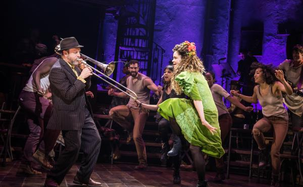 Brian Drye plays trombone with Tony-nominated actress Amber Grey onstage in Hadestown.