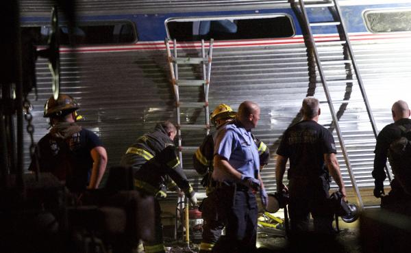 Emergency workers search for injured passengers after an Amtrak train carrying more than 230 people from Washington, D.C., to New York derailed in Philadelphia in May 2015.