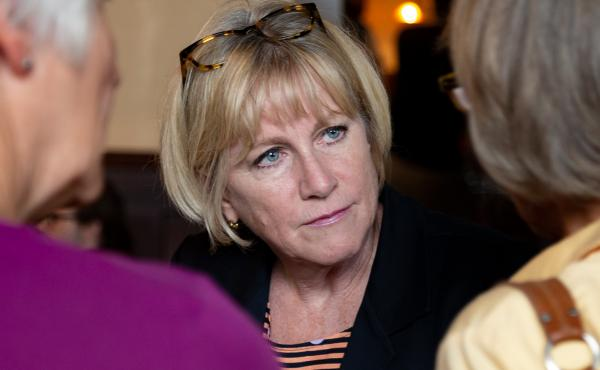 Democratic gubernatorial candidate Cathy Glasson campaigns one week before the primary election in a Des Moines restaurant. She says she thinks in order to win against Republican Gov. Kim Reynolds, she and her fellow candidates need to run far to the left