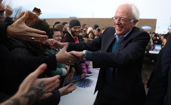 Vermont Sen. Bernie Sanders greets people at a campaign field office in Cedar Rapids, Iowa. Sanders is the slight favorite to win the caucuses, and he hopes it vaults him to the Democratic nomination.