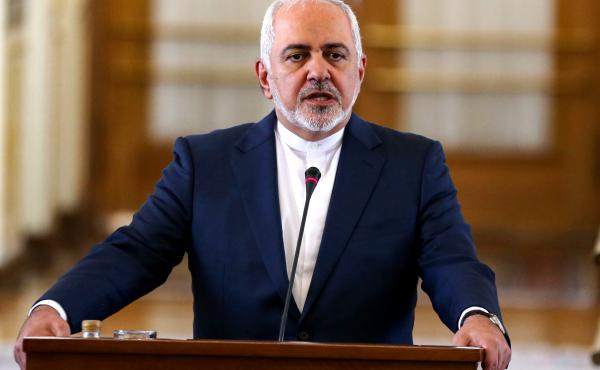 Iran has exceeded a key limit on its holdings of low-enriched uranium, Foreign Minister Mohammad Javad Zarif said on Monday. Zarif is seen here at a news conference last month.