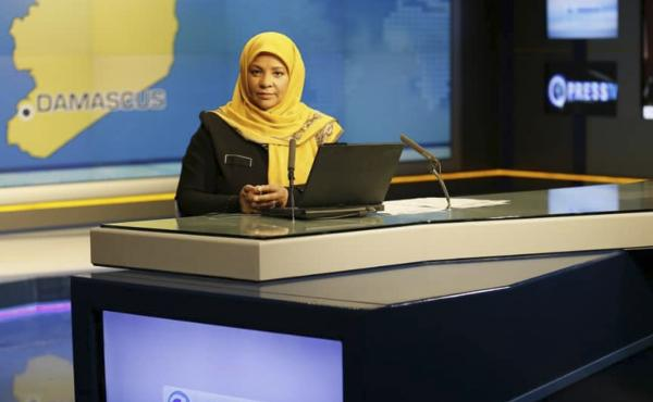 American-born news anchor Marzieh Hashemi sits in a studio in Tehran, Iran. Her eldest son said Wednesday that she was detained on Sunday and is being held without charge.