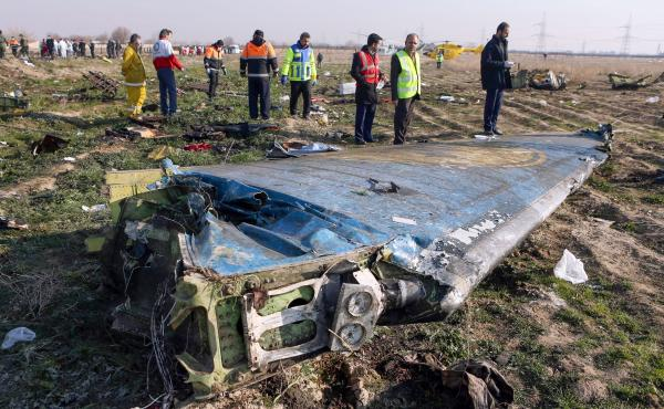 Rescue teams examine the wreckage of the Ukrainian airliner that was shot down shortly after takeoff in the Iranian capital, Tehran, on Jan. 8. Iran says a tragic series of mistakes led to the missile strike.