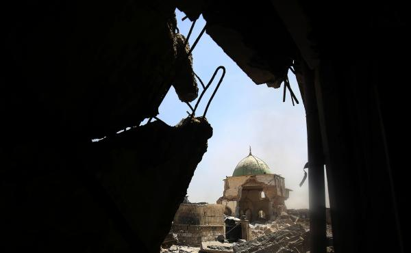 "The ravaged Great Mosque of al-Nuri, as seen through rubble in the Old City of Mosul on Thursday. Iraqi forces say they've recaptured the landmark, where ISIS leader Abu Bakr al-Baghdadi declared the group's ""caliphate"" in 2014."