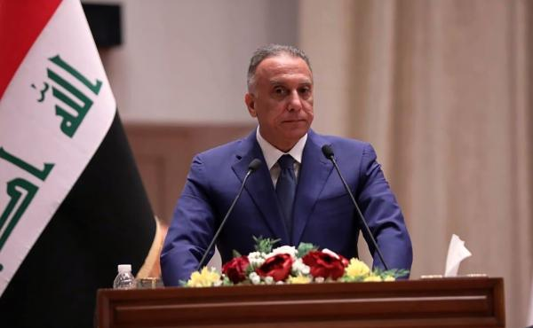 Mustafa al-Kadhimi speaks to Parliament in Baghdad on Thursday. Iraq's former spy chief was sworn in early Thursday as prime minister after weeks of tense political negotiations as the country faces a severe economic crisis spurred by the coronavirus pand