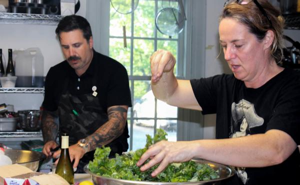 "Chef Michael Scelfo of Cambridge, Mass., left, and Lisa Carlson, who operates three food trucks in Minneapolis, collaborate on the Glynwood dinner's spelt salad with lamb tongues and hearts, and ""ugly"" cherries, shiitakes, and kale."