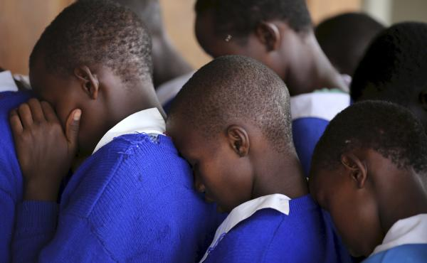 Students rehearse a poem that they will recite at an event advocating against female genital mutilation at the Imbirikani Girls High School in Kenya.