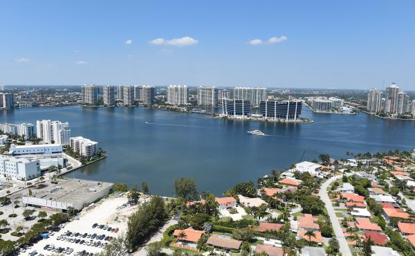 A new study has found that home sale prices and volume appear to be declining in Florida coastal areas at vulnerable to rising sea levels compared to coastal areas with less risk. Here, the balcony view from a luxury condo in Sunny Isles Beach, Fla., in 2
