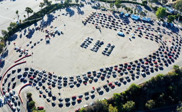 Cars are lined up at Dodger Stadium in Los Angeles for coronavirus testing. Nearly 2 million people are getting tested a day in the U.S. A new analysis shows millions more are needed to protect the most vulnerable.