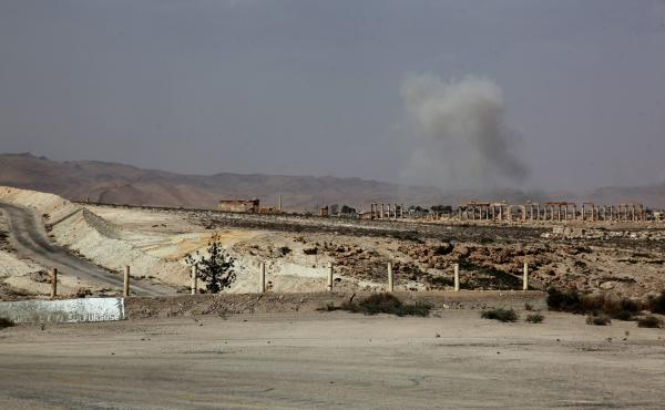 Smoke rises after a Syrian Rocket launcher shell on Islamic State positions in the ancient oasis city of Palmyra, about 215 kilometers northeast of Damascus on Tuesday. News reports say the Islamic State has taken control of the city.