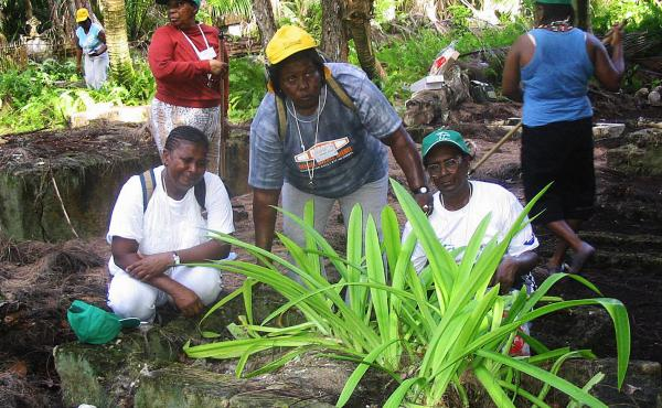 Chagossians weep at the grave of their parents on Peros Banos Island April 10, 2006. Fifteen elders are allowed to visit once a year.