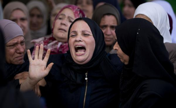 Relatives of Aisha Rabi, 48, mourn at the family home during her funeral in the West Bank village of Bidya in October 2018.
