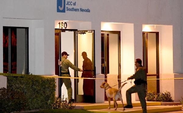 Las Vegas Metropolitan Police Department K-9 officers search the Jewish Community Center of Southern Nevada after an employee received a suspicious phone call that led to the evacuation of about 10 people from the building on Feb. 27. A suspect in Israel