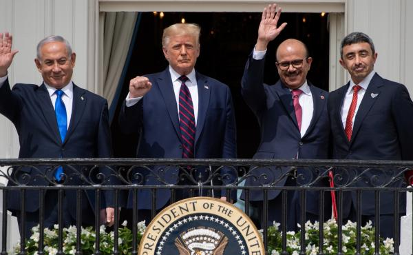Israeli Prime Minister Benjamin Netanyahu (from left), President Trump, Bahraini Foreign Minister Abdullatif bin Rashid Al Zayani and Emirati Foreign Minister Abdullah bin Zayed Al Nahyan wave from the Truman Balcony at the White House. The group particip