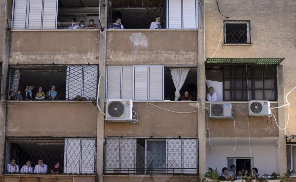 Ultra-Orthodox Jews watch a funeral for Rabbi Mordechai Leifer from their balconies in the port city of Ashdod, Israel, on Oct. 5. The rabbi, who had been the spiritual leader of a small ultra-Orthodox community founded a century ago in Pittsburgh, died a