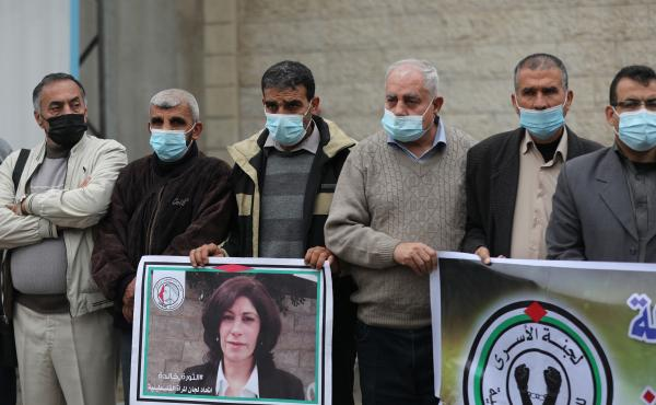 Members of the Palestinian Prisoner Society stage a demonstration outside the International Committee of the Red Cross building, demanding the World Health Organization put pressure on Israeli authorities to vaccinate Palestinian prisoners in Israeli jail