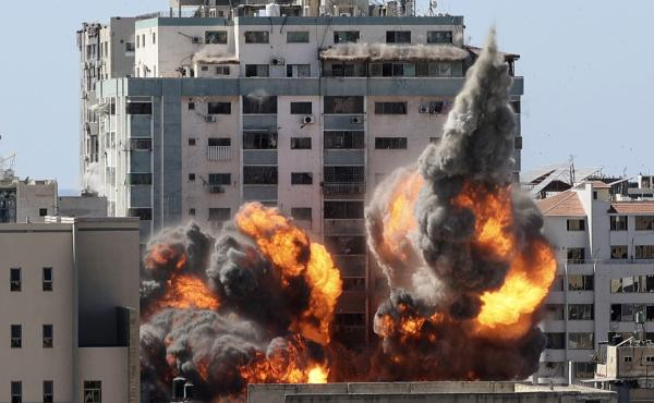 A ball of fire erupts from a building housing various international media, including The Associated Press, after an Israeli airstrike on Saturday in Gaza City. AP staffers and other tenants safely evacuated the building after the Israeli military telephon