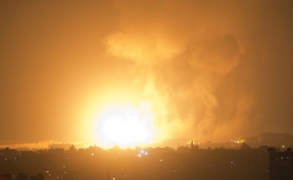 An explosion caused by an Israeli airstrike on Gaza City early Thursday.