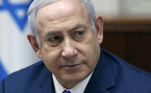 Israeli Prime Minister Benjamin Netanyahu attends the weekly Cabinet meeting at his office in Jerusalem on Sunday. Israeli police have recommended indicting Netanyahu on bribery charge allegations related to a corruption case involving Israel's Bezeq tele