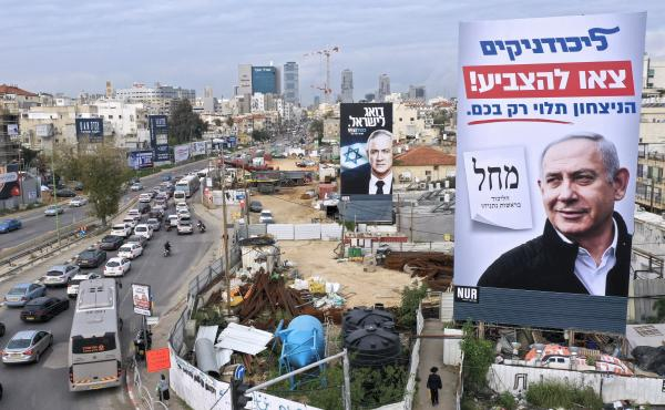 "Election campaign billboards show Israeli Prime Minister Benjamin Netanyahu (right) and rival candidate Benny Gantz, in Bnei Brak, Israel, on Feb. 23. The sign in the foreground, for Netanyahu's Likud party, reads ""Likud members, go out to vote, victory d"