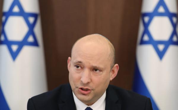 Israeli Prime Minister Naftali Bennett attends a cabinet meeting at the prime minister's office in Jerusalem on Sunday, July 4, 2021.