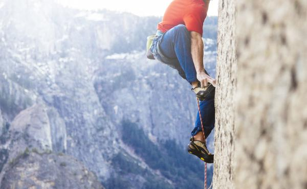 """Tommy Caldwell uses """"tiny razorblade edges"""" in the rock wall to support his body weight on El Capitan's Dawn Wall."""