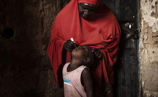 A child receives a polio vaccine during National Immunization Days in the Nigerian city of Kano.