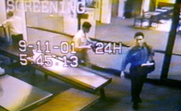 Two men identified by authorities as hijackers Mohamed Atta (right) and Abdulaziz Alomari (center) pass through airport security on Sept. 11, 2001, at Portland International Jetport in Maine in an image from airport surveillance tape released on Sept. 19,