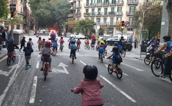 Children joining the bicibús in the Eixample district of Barcelona, Spain, make their way to school on a recent Friday morning. The community is hoping to build a school-friendly bike lane for a safer commute for kids.