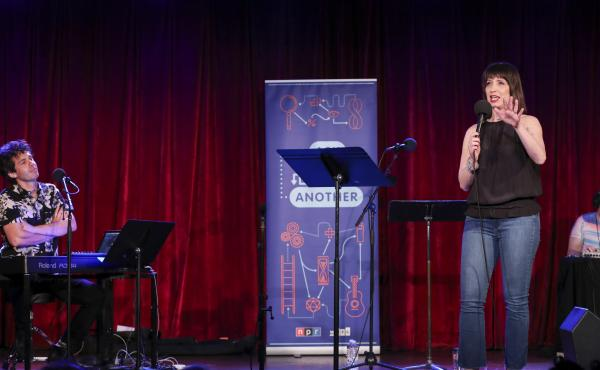 Ophira Eisenberg performs on stage alongside Julian Velard on Ask Me Another at the Bell House in Brooklyn, New York.