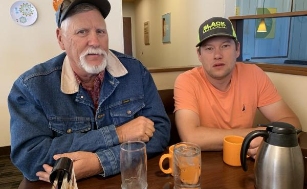 Ty Cordingly and his dad at a local Gillette diner. He's seen coworkers leave the state for jobs and thinks Wyoming relies too much on the energy industry.