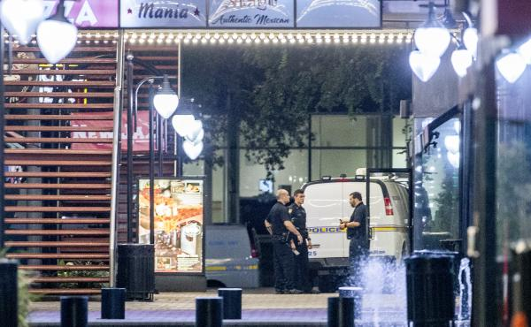 A heavy police presence remained into the night at the scene of the shooting inside Jacksonville Landing on Sunday in Jacksonville, Fla.