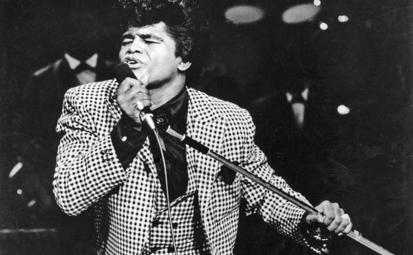 James Brown performs onstage at the TAMI Show on December 29, 1964 at the Santa Monica Civic Auditorium in California.