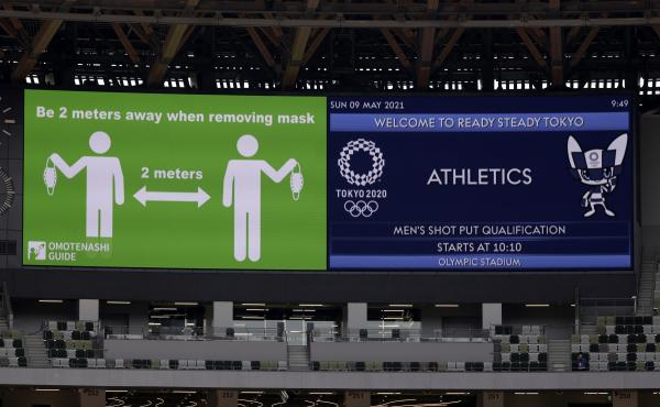 Signs on a screen are shown before an athletics test event for the Tokyo 2020 Olympic Games last month at the National Stadium in Tokyo.