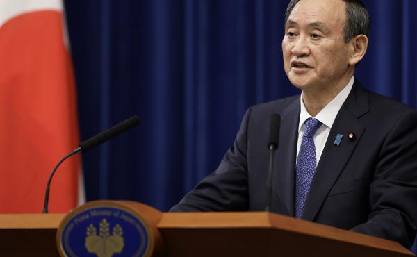 Japan's Prime Minister Yoshihide Suga speaks during a news conference Thursday in Tokyo, where he declared a state of emergency for Tokyo and neighboring prefectures amid a new surge in COVID-19 cases.