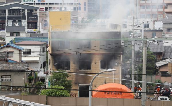 Smoke rises from an animation company building after a fire in Kyoto on Thursday.
