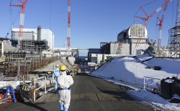 The Japanese government says that a worker at the Fukushima nuclear power plant died as a result of radiation exposure.