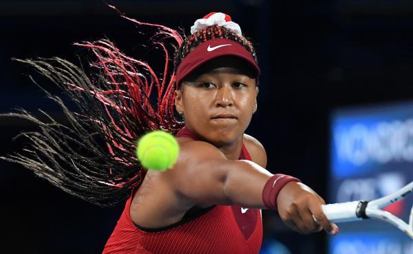 Japan's Naomi Osaka returns the ball to the Czech Republic's Marketa Vondrousova during their third round tennis match at the Tokyo Games on Tuesday.