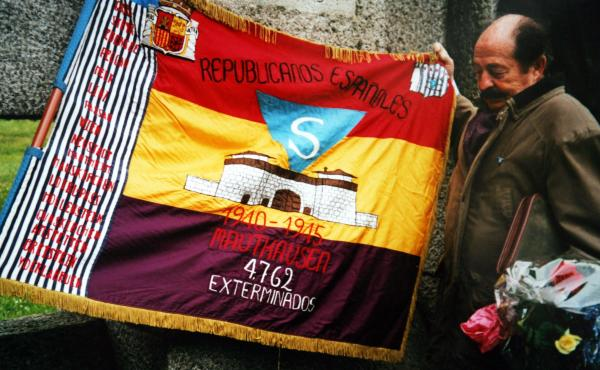 Enric Marco stands next to a Spanish Republican flag at Mauthausen camp in Austria in May 2003. Marco, who was chairman of an association of Spanish Republicans deported from France to Nazi concentration camps during World War II, admitted in May 2005 tha