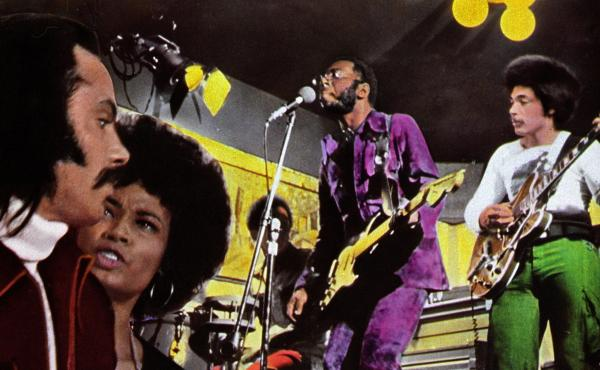 Curtis Mayfield (in purple) performs in a detail from a poster advertising the 1972 film Super Fly, for which Mayfield composed the soundtrack album.