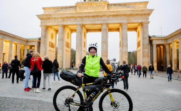 Scottish cyclist Jenny Graham stands at the Brandenburg Gate in Berlin after she circumnavigated the world by bicycle in just under 125 days.